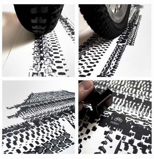 用轮胎做笔画天安门